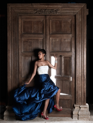 Female model poses by Indian door Alice in Wonderland Elle Magazine