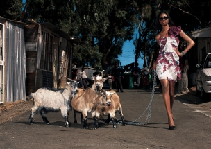 Female model with goats in African Township Elle Magazine