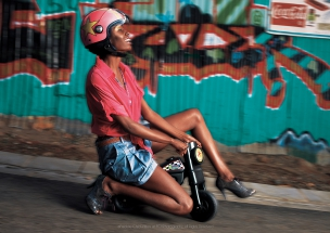Female model on tricycle in African Township Elle Magazine