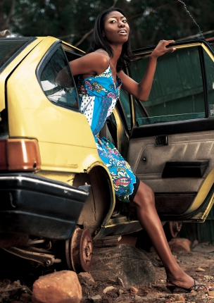 Female models getting out of car in African Township Elle Magazine